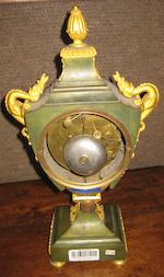An Empire gilt and patinated bronze shield form mantel clock<BR />dial signed Bergmiller<BR />early 19th century