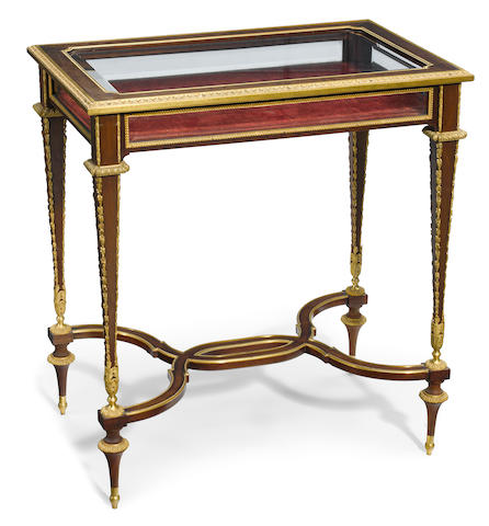 A Louis XVI style gilt bronze mounted mahogany bijouterie table  late 19th century