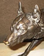 A French patinated bronze and white marble study of a wolf <BR />after a model by Charles Valton (French, 1851-1918)<BR />Colin foundry, Paris<BR />late 19th/early 20th century