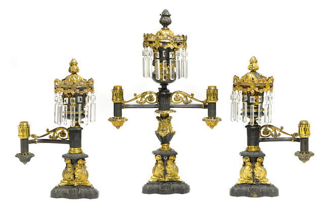 A George IV gilt and patinated bronze three piece garniture of argand lamps  Messenger & Son, London circa 1825