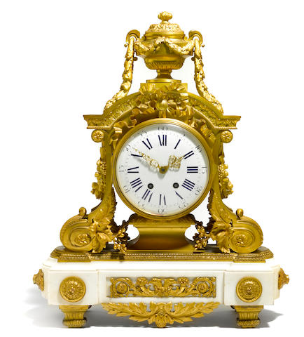 A good and imposing Louis XVI style gilt bronze and marble mantel clock  late 19th century