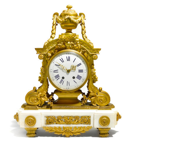A Louis XVI style gilt bronze and marble mantel clock