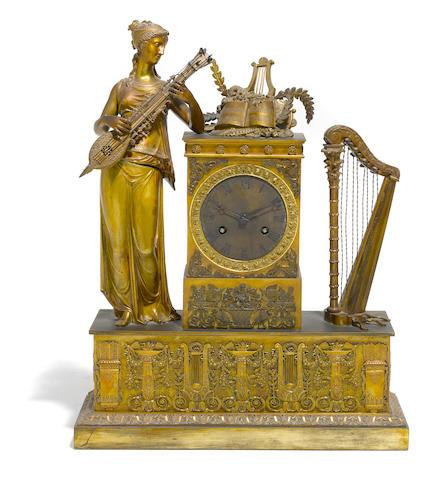 An Empire gilt bronze mantel clock  <BR />first quarter 19th century