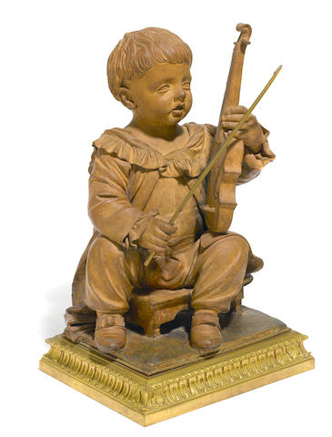 A French terracotta figure of a child musician <BR />19th century