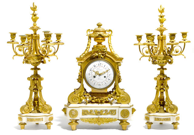 A fine and rare Louis XVI style gilt bronze and marble double-sided clock and matching candelabra <BR />Denière à Paris<BR />second half 19th century