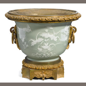 A French gilt bronze mounted and Chinese porcelain jardinière  . bronze late 19th century, porcelain 20th century