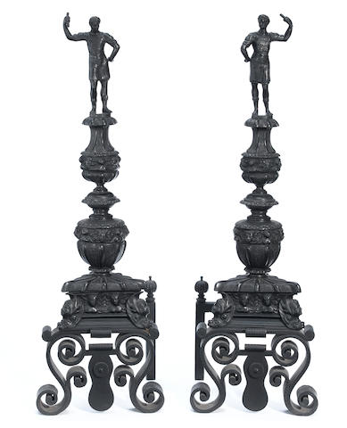 A pair of Renaissance Revival patinated bronze andirons <BR />early 20th century