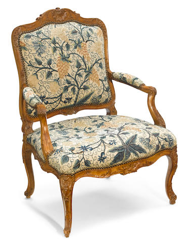 A Louis XV carved walnut fauteuil <BR />third quarter 18th century