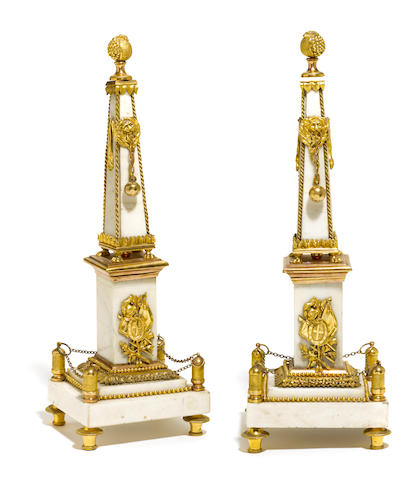 A pair of French gilt bronze and marble obelisks <BR />early 20th century