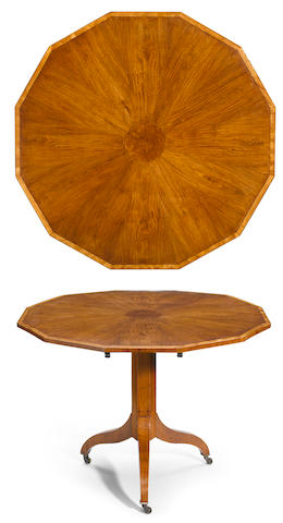 A Regency satinwood crossbanded tilt top center table  early 19th century