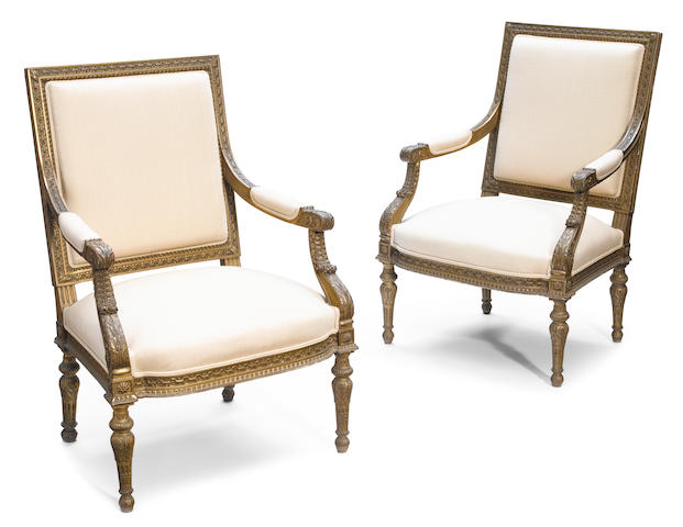 A pair of Louis XVI style carved giltwood fauteuils  <BR />late 19th century
