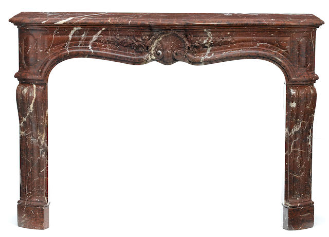A Louis XVI style carved rouge marble fire surround   <BR />late 19th century