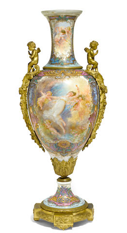 A Sèvres style porcelain gilt bronze mounted urn  early 20th century
