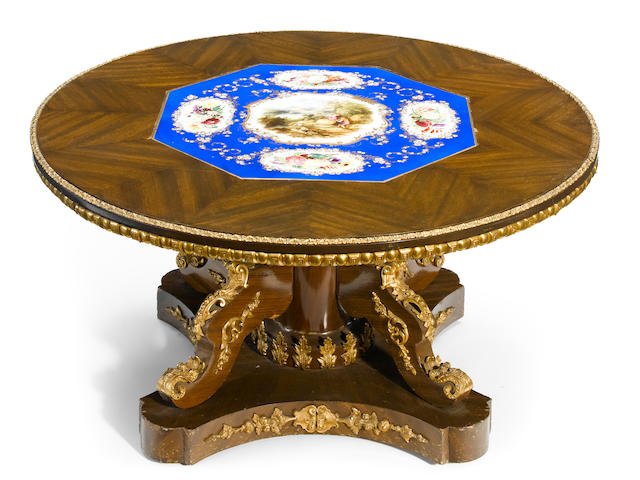 A French gilt bronze mounted porcelain and mahogany coffee table