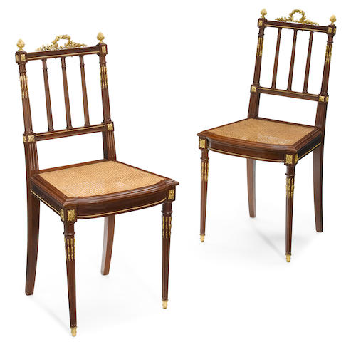 A pair of Louis XVI style gilt bronze mounted mahogany side chairs <BR />circa 1900