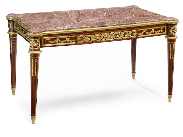 A Louis XVI style gilt bronze mounted mahogany table de milieu <BR />late 19th century