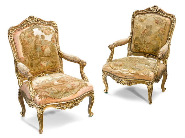 A pair of Louis XV style carved giltwood and parcel paint decorated fauteuils <BR />late 19th century