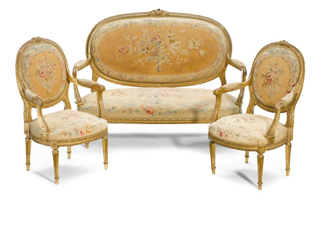 A suite of Louis XVI style carved giltwood seat furniture  <BR />late 19th century