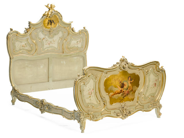 An impressive Continental Rococo style parcel gilt and paint decorated suite of bedroom furniture <BR />late 19th century