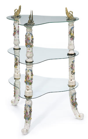 A German porcelain gilt metal and glass three tier étagère  <BR/>composed of late 19th century and later elements