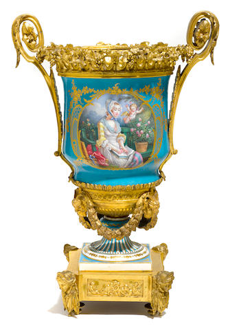 A large Sèvres style porcelain gilt bronze mounted urn