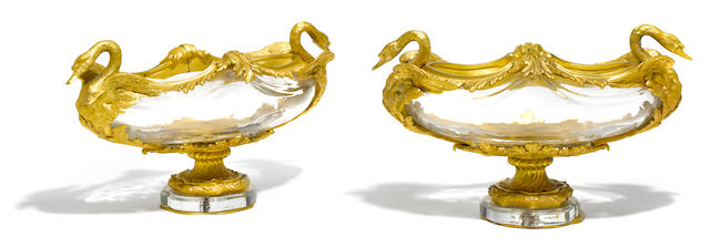 A pair of French gilt bronze mounted glass centerpieces