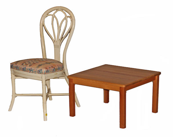 A contemporary butcher block low table together with a hoop back bamboo upholstered side chair