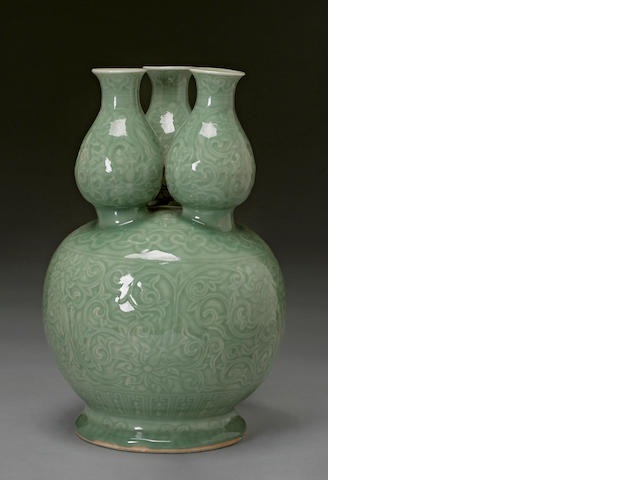 A celadon glazed porcelain triple spouted gourd shaped vessel Guangxu mark, Republic period