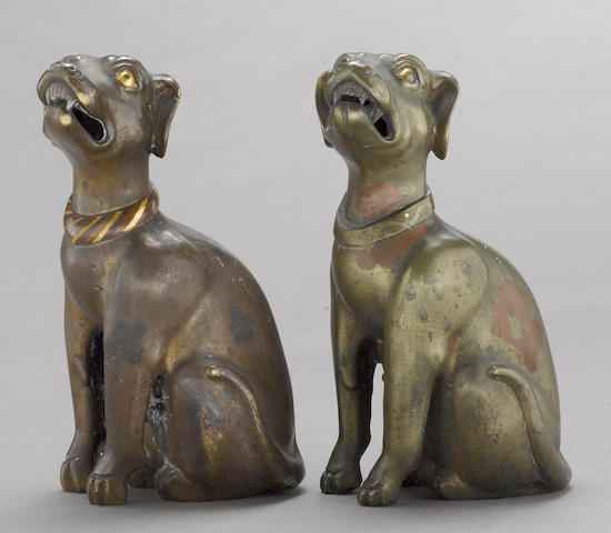 A pair of bronze dogs with colored lacquer and mixed metal inlay