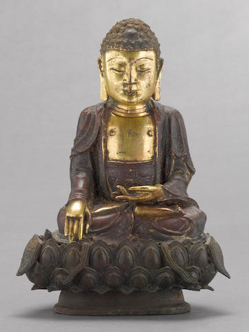 A parcel-gilt bronze seated figure of the Buddha
