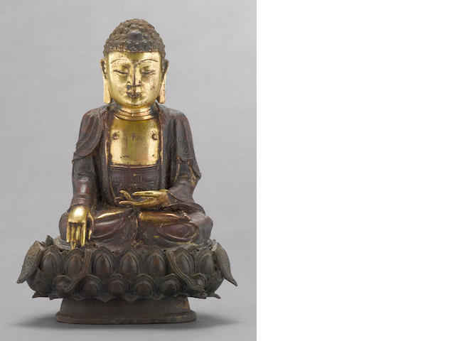 A parcel-gilt bronze seated figure of Buddha