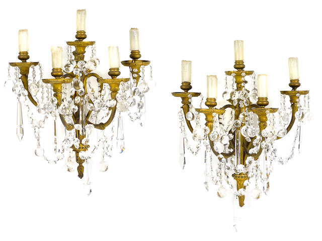 A pair of Louis XVI style gilt bronze and glass five light bras de lumière <BR />late 19th century