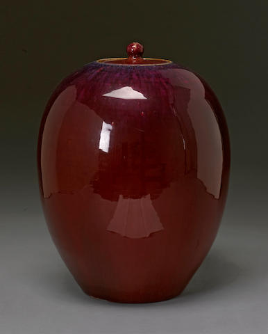 A transmutation red glazed porcelain covered jar Late Qing/Republic perid