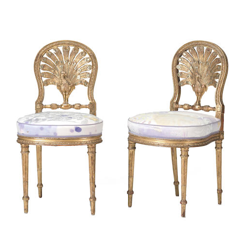 "A pair of Neoclassical style giltwood ""peacock"" side chairs <BR />late 19th century"