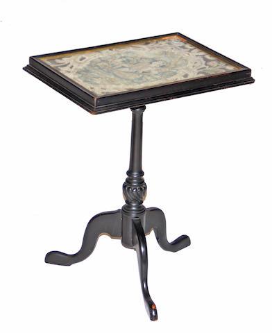 A George III style needlework mounted ebonized tripod table early 20th century, needlework 19th century