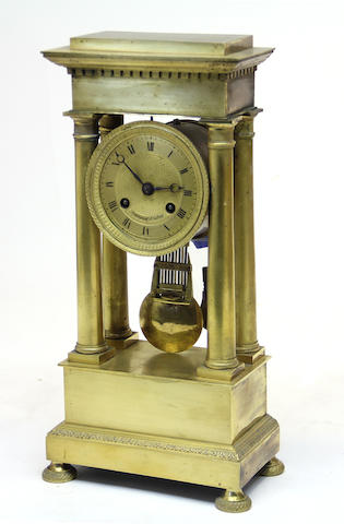 A Louis Philippe gilt bronze portico clock second quarter 19th century