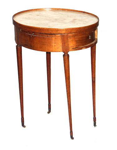 A Louis XVI walnut oval table en chiffonier fourth quarter 18th century