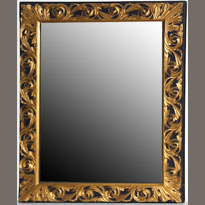 A Baroque style gilt and parcel ebonized mirror 19th century