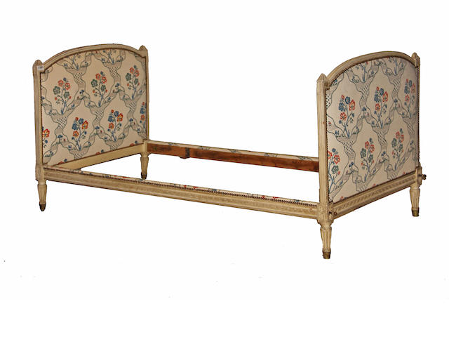 A pair of Louis XVI style cream painted beds 19th century