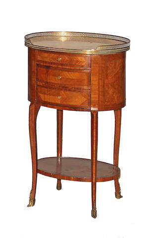 A Louis XVI style oval inlaid walnut commode en chiffonnier first half 20th century