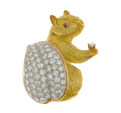 A diamond and eighteen karat gold squirrel brooch