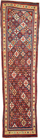 A Gendje runner Caucasus size approximately 3ft. 2in. x 12ft. 3in.