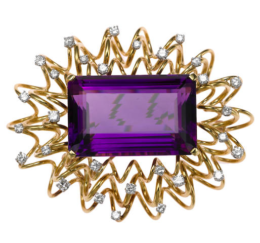 An amethyst and diamond pendant/brooch