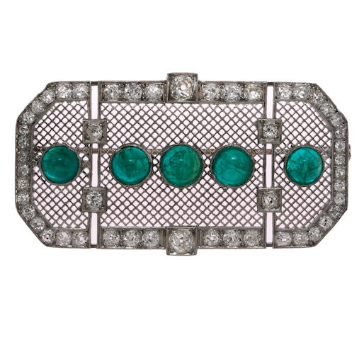 An art deco emerald and diamond pendant/brooch,