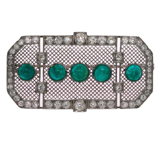 An art deco emerald and diamond pendant/brooch,