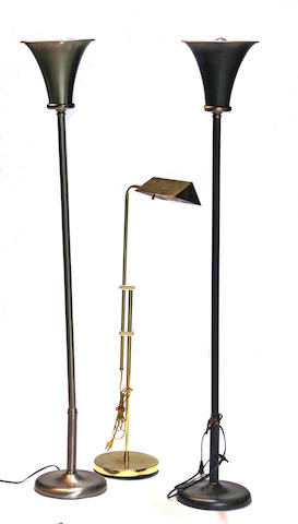 A set of three contemporary brass floor lamps