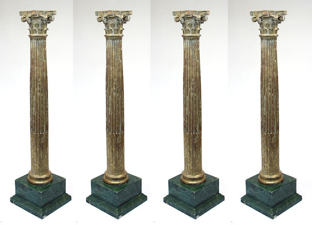 A set of four Continental, probably Italian, Neoclassical giltwood columns 18th/19th century