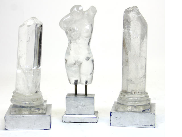 Two rock crystal ruined columns and rock crystal female torso each on silvered display stands