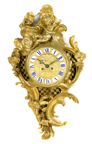 A Louis XV style gilt bronze cartel clock  late 19th century