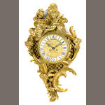 A Louis XV style gilt bronze cartel clock <BR />late 19th century